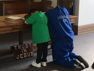 Father and son praying RHC 2016
